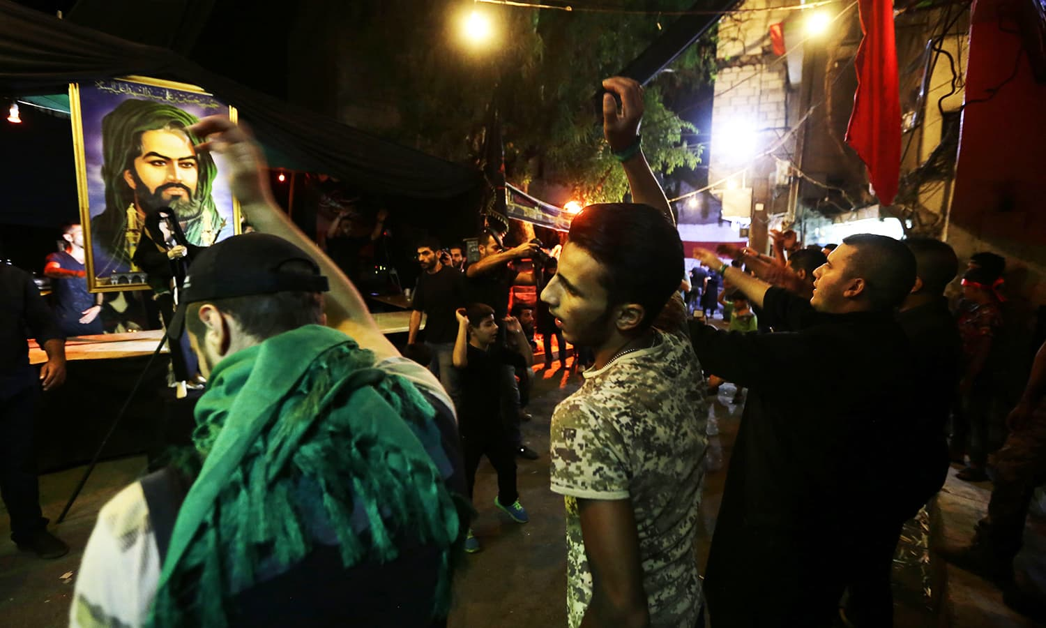 Syrian mourners take part in commemorations marking the mourning period of Ashura in Zine-el-Abidine neighbourhood in the capital Damascus. ─ AFP