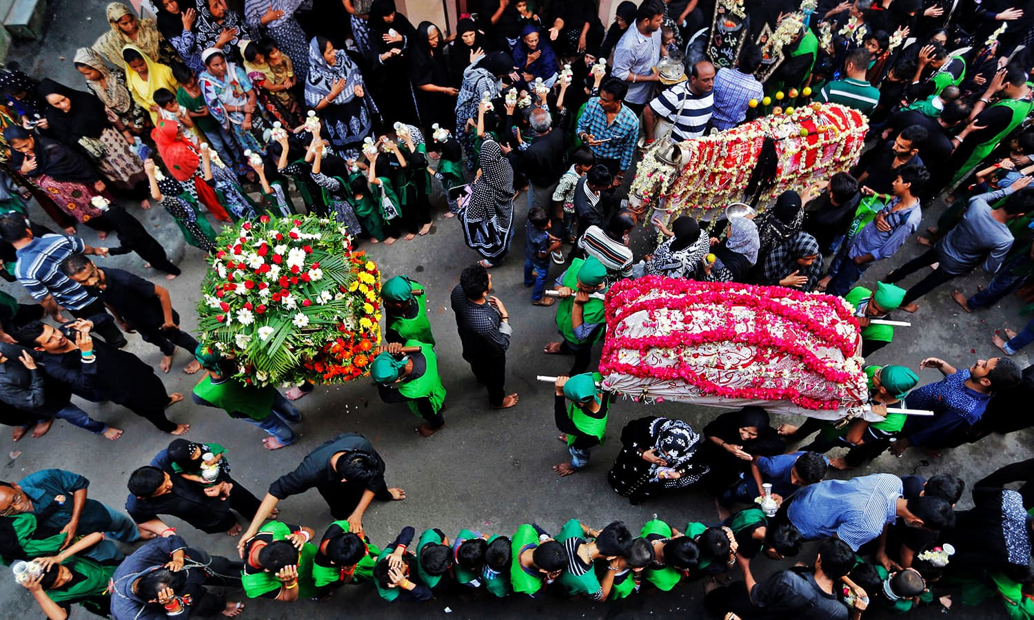 Mourners take part in a Muharram procession in Ahmedabad, India. ─ Reuters