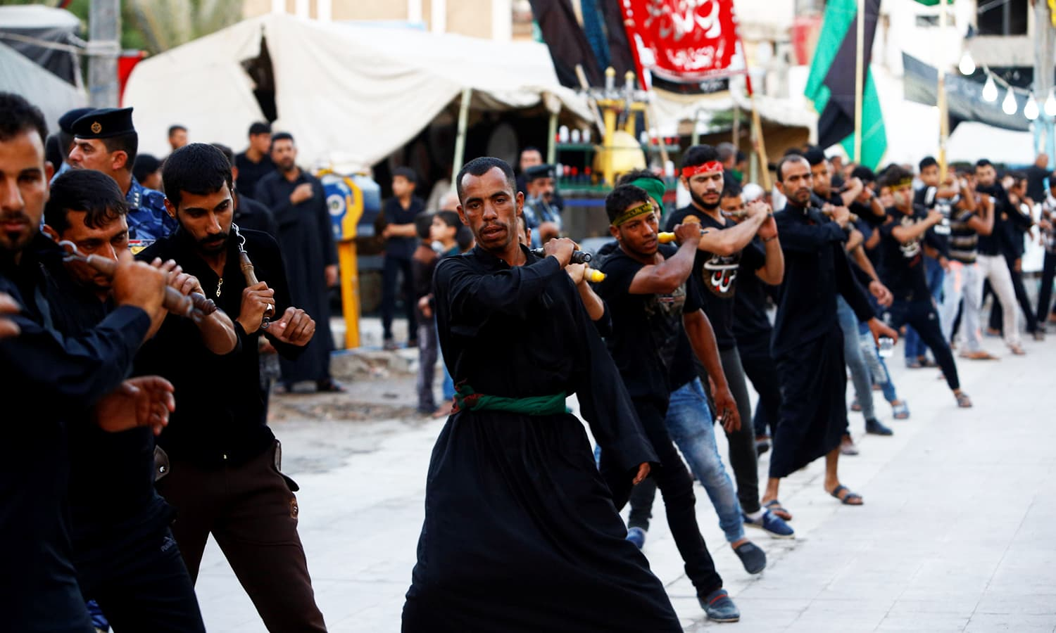 Mourners commemorate Ashura in Najaf, Iraq. ─ Reuters