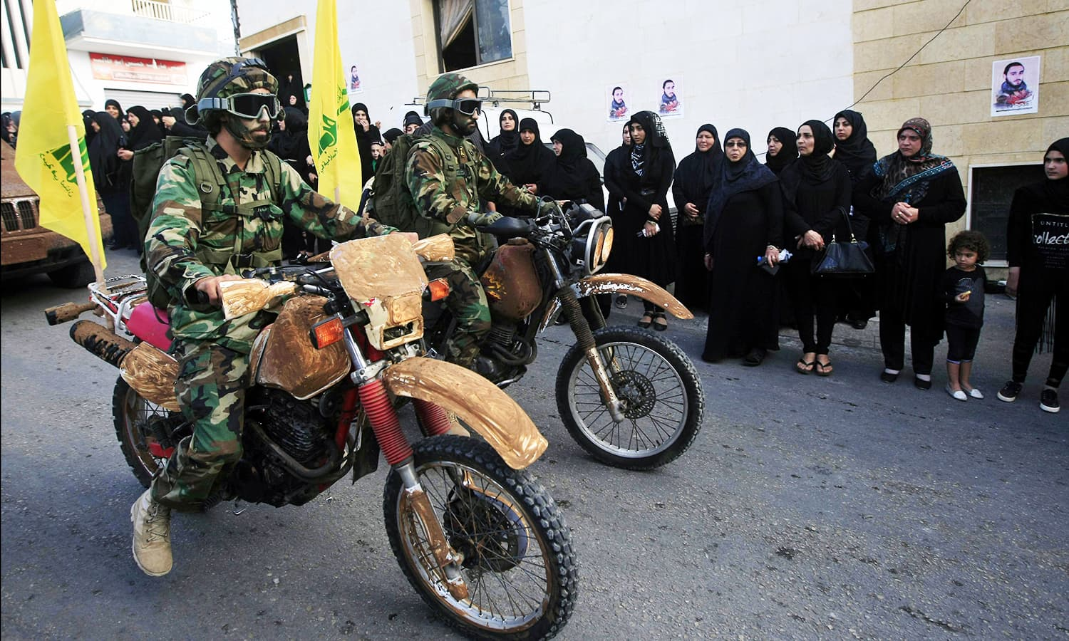 Hezbollah fighters drive motorbikes as they parade during a rally to mark the seventh day of Ashoura in the southern village of Seksakiyeh, Lebanon. ─ AP
