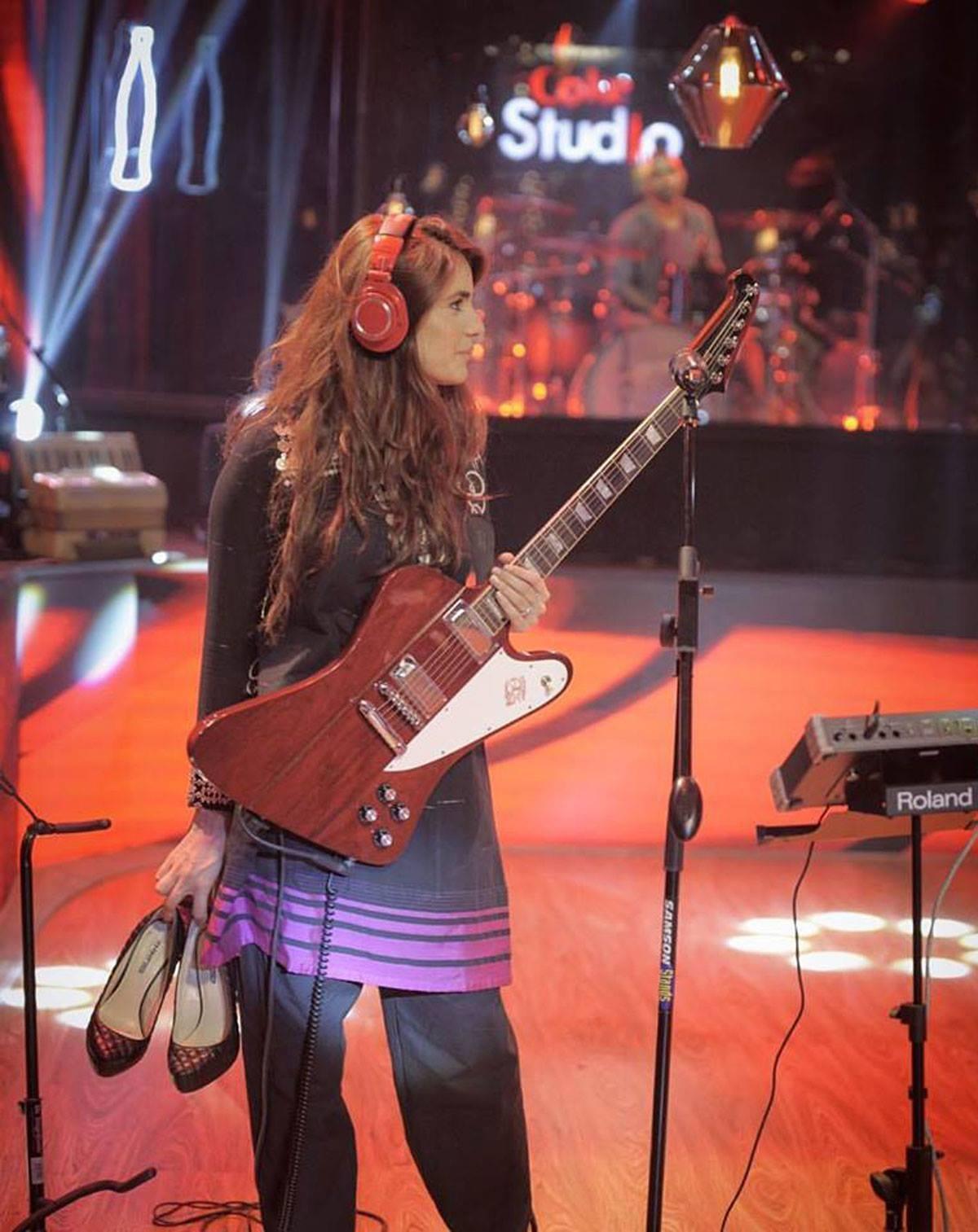 Momina prepping for her killer guitar solo in Main Rasta