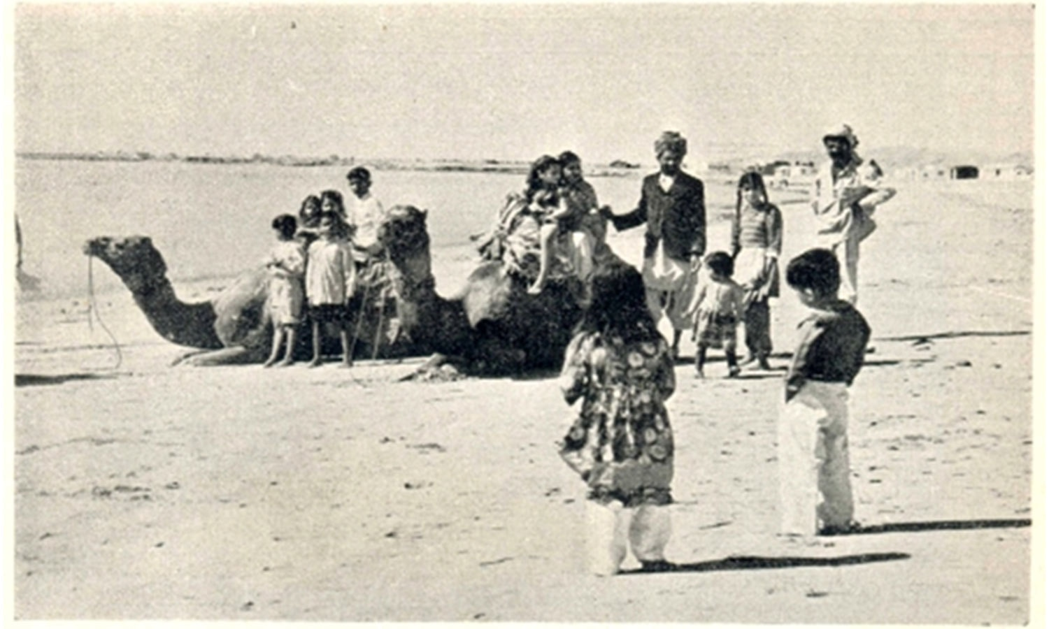Families enjoy a camel ride on the shores of Clifton Beach in the 1950s. A mammoth shopping mall stands at this very spot today.