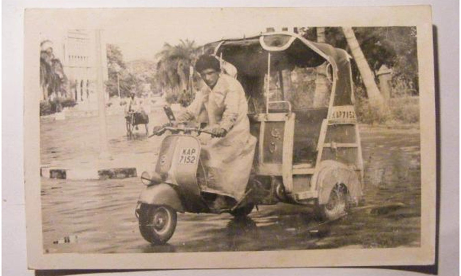 A Rickshaw driver on Frere Road heading towards the Clifton Beach in 1965 after that year's heavy monsoon downpours and a tidal wave which hit Karachi's coastline.
