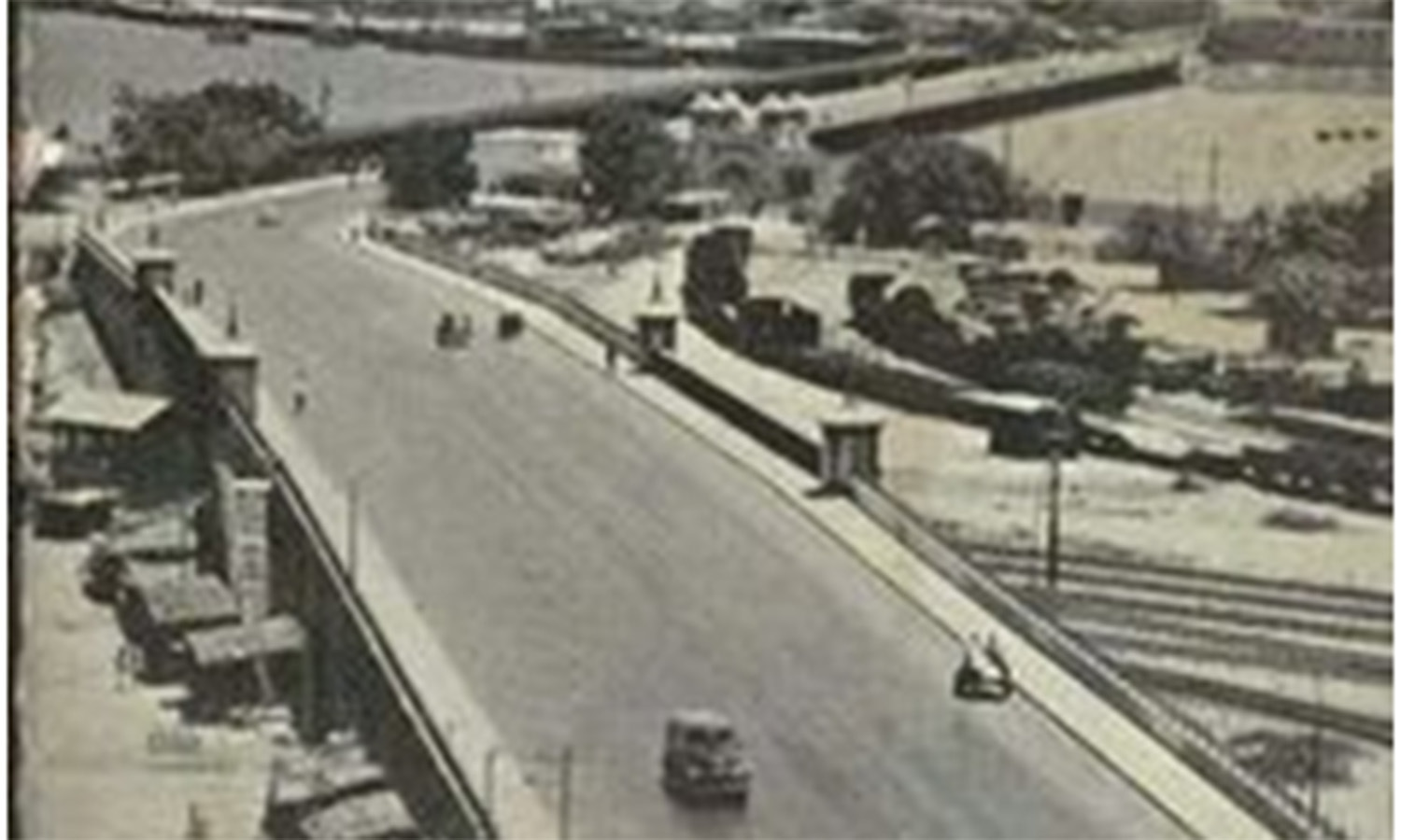 The Native Jetty Bridge in 1957. It begins where Queens Road ends. It was built in 1954. It connects the city to the Karachi Port.