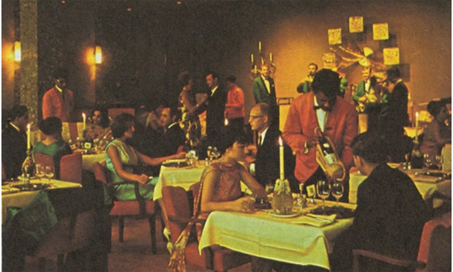 Locals and foreigners wine and dine at a restaurant at the Beach Luxury Hotel in 1969. The hotel was built laterally to a mangrove forest in the Queens Road area.
