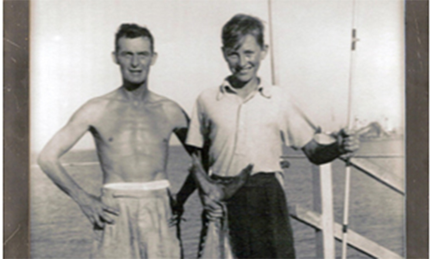 A British expat and his son pose for the camera with their catch at the Karachi Fish Harbour in 1957.