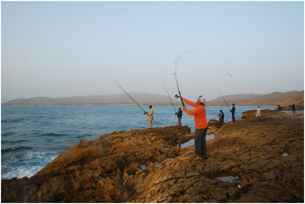 Men fishing at the Mubarak Village Beach.