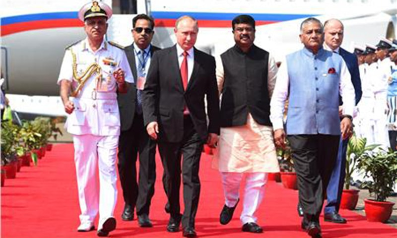 Russian President, Vladimir Putin is accompanied by Indian Minister of State for External Affairs, General V K Singh on his arrival at the airport in Goa ─AFP