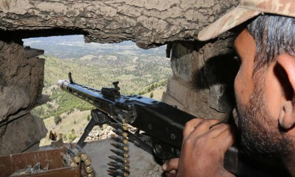 A soldier looks out from his post on top of a mountain in Waziristan | AFP