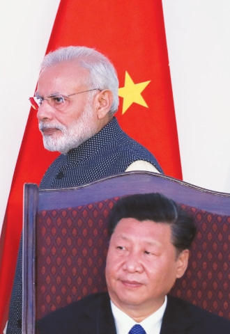 INDIAN Prime Minister Narendra Modi walks past Chinese President Xi Jinping after delivering a statement at the BRICS summit.—AP