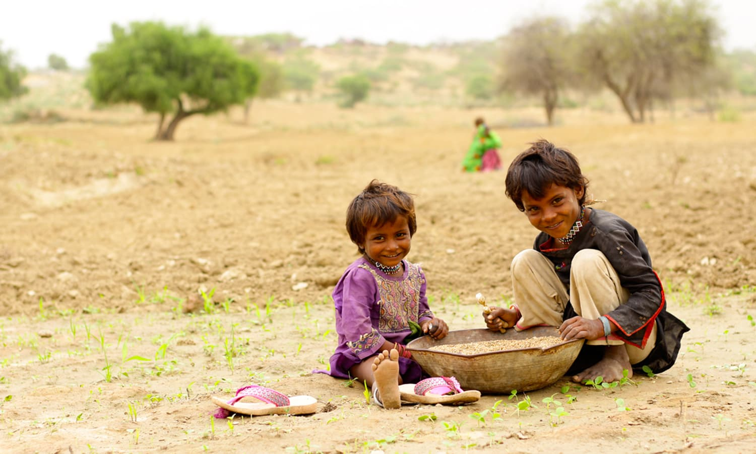 Rain and good harvest brings happiness on the faces of children.