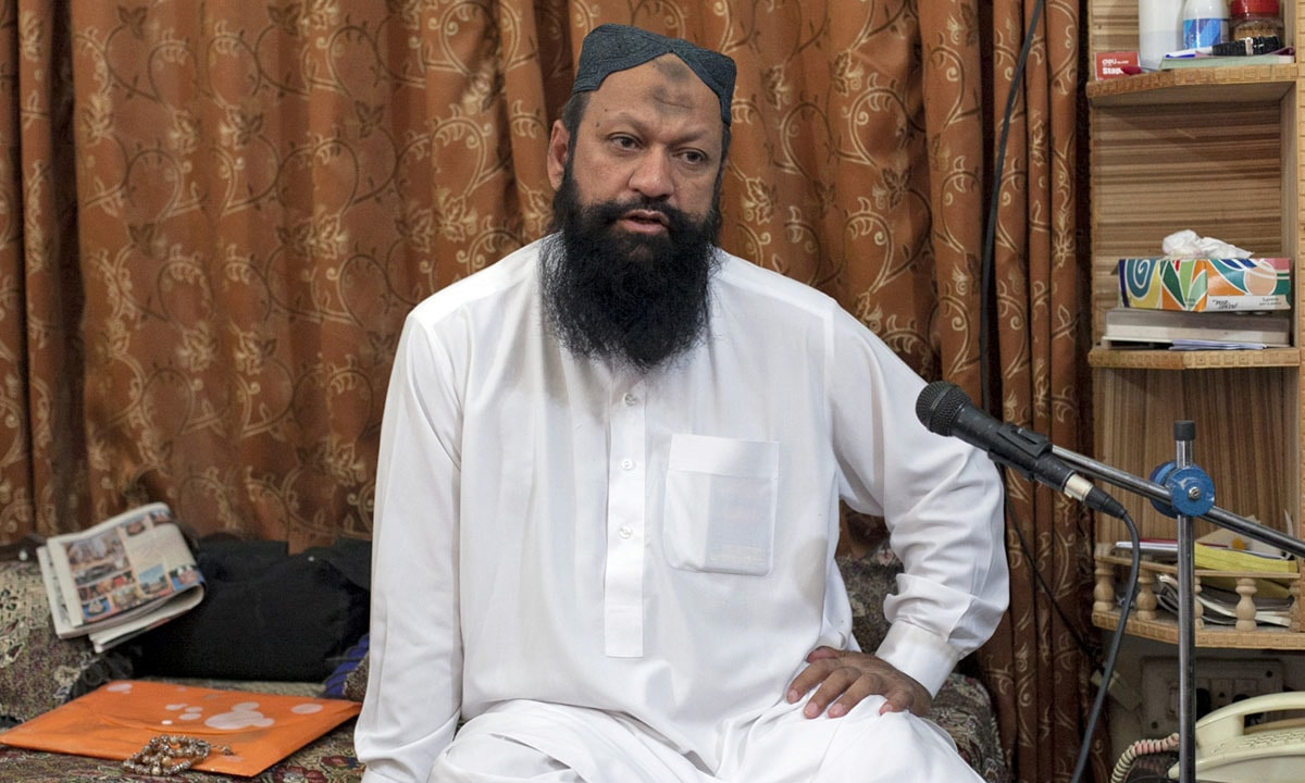 Malik Ishaq during an interview | Reuters