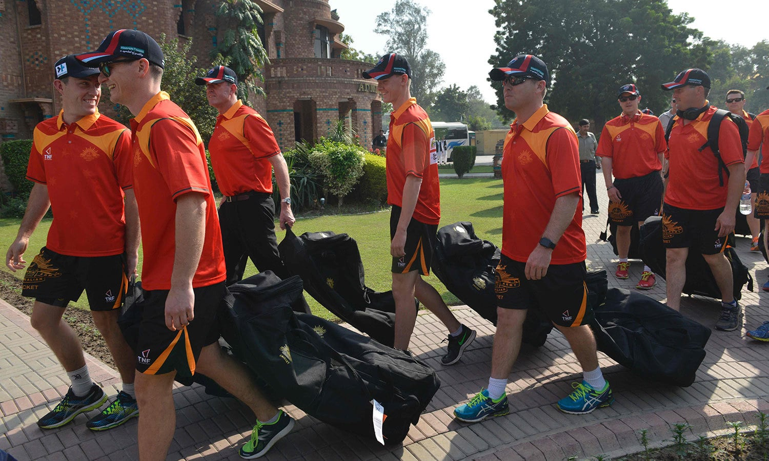 Members of the Australian army cricket team arrive for practice at the National Cricket Academy ahead of the First International PACES Competition 2016. ─AFP