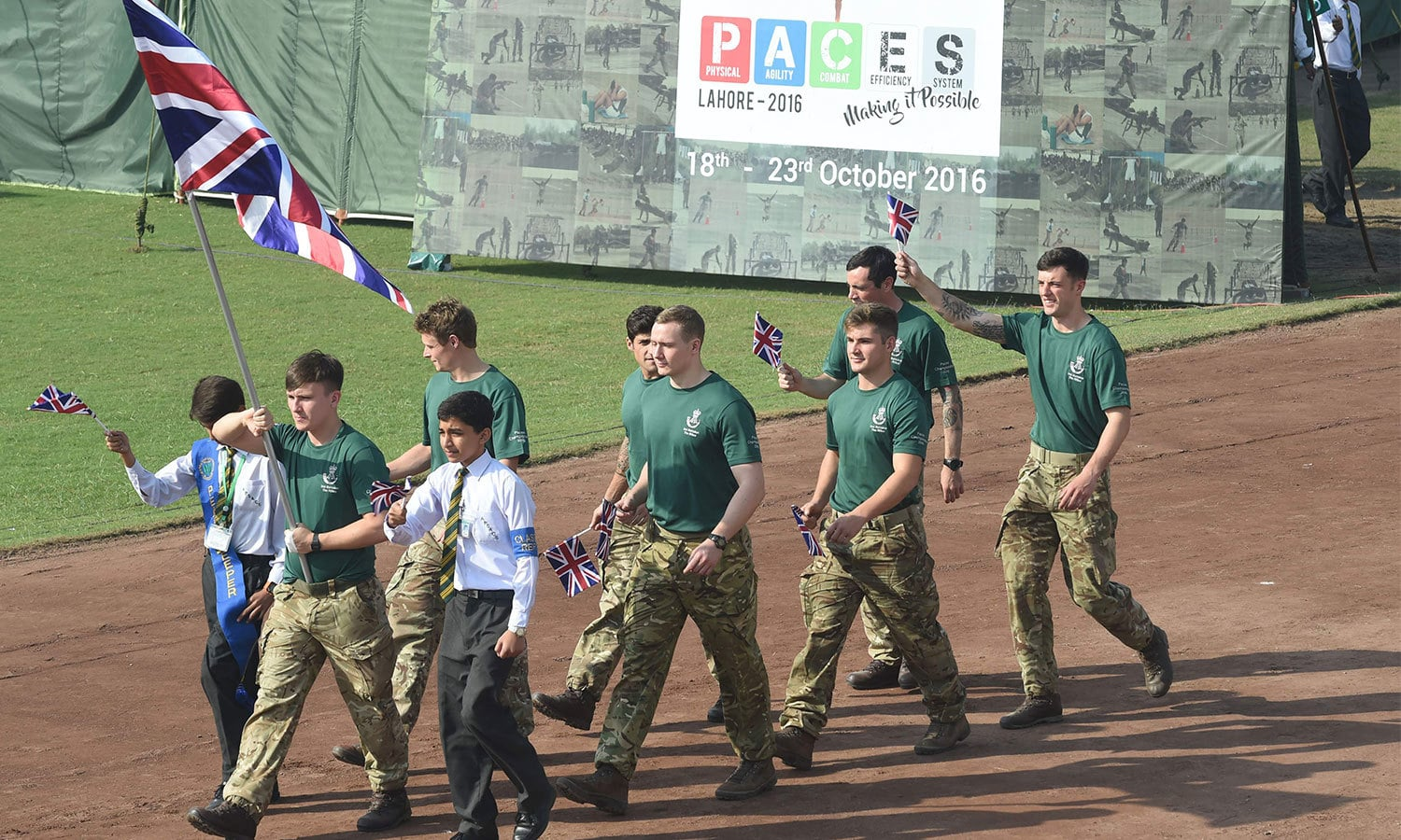 The British Army team arrives at the opening ceremony of the First International PACES Competition 2016 in Lahore. ─AFP