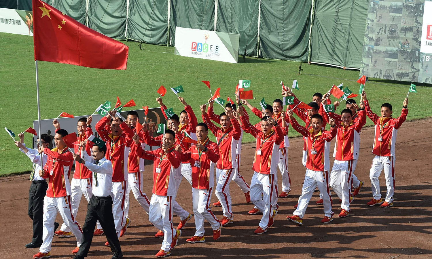 The Chinese Army team arrives at the opening ceremony. ─AFP
