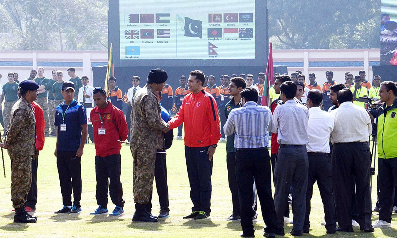 Corps Commander Lt. General Sadiq Ali shaking hand with players during opening ceremony. —APP