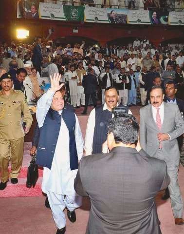 ISLAMABAD: Prime Minister Nawaz Sharif waves to party workers and leaders after his unopposed election as PML-N president by its General Council at the Convention Centre on Tuesday.—APP