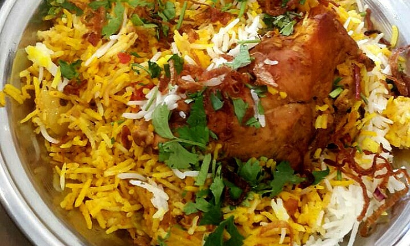 The first bite of this chicken biryani let loose the taste of mint, dried plum and lemon zest all at the same time in my mouth