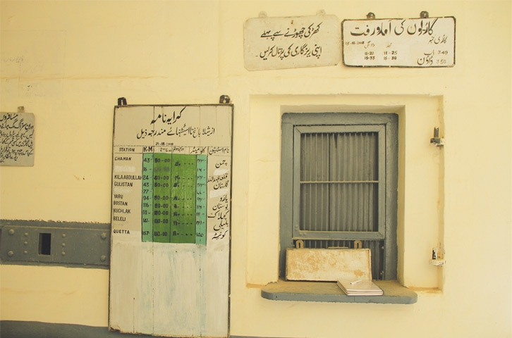 Vintage signboards are still in use at the ticket booth of the train station of Shela Bagh