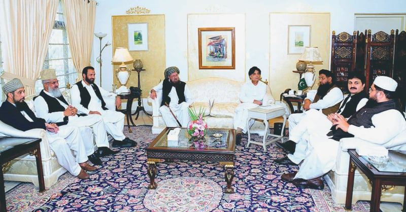 ISLAMABAD: A delegation of the Difa-i-Pakistan Council led by Maulana Samiul Haq calling on Interior Minister Chaudhry Nisar Ali Khan at Punjab House on Friday.—APP