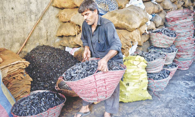It is always wise to wear black when handling charcoal./ Photos by Fahim Siddiqi / White Star