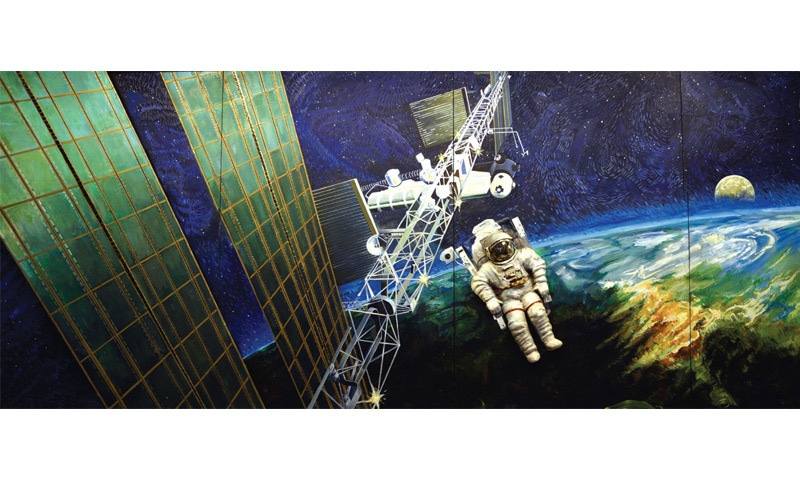 A poster at the institute depicts an astronaut in space.