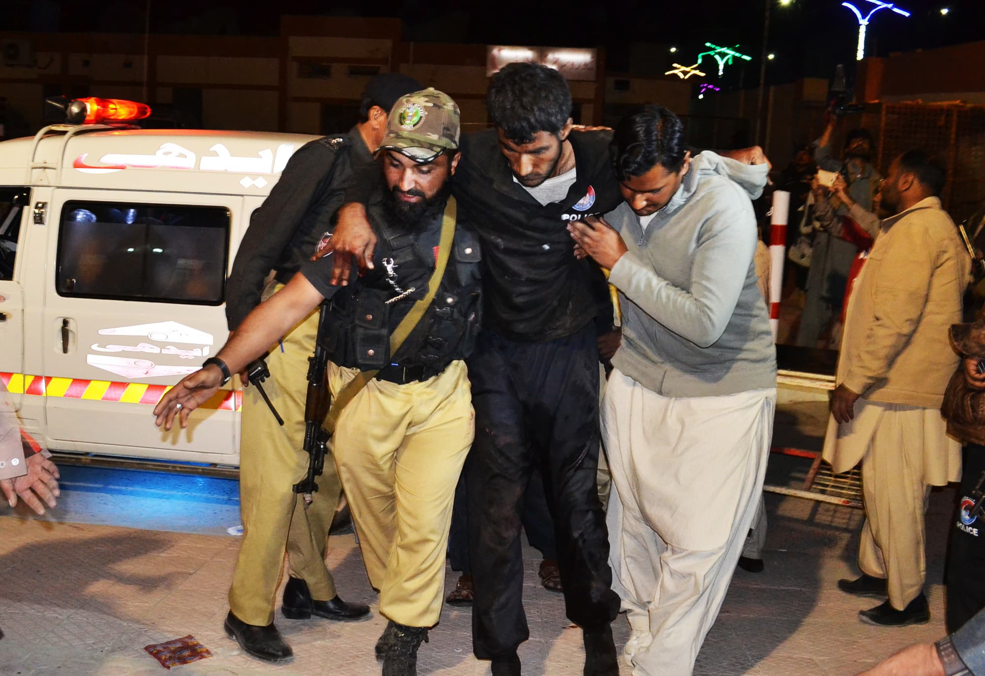 A volunteer and a police officer rush an injured person to a hospital in Quetta. — AP/File