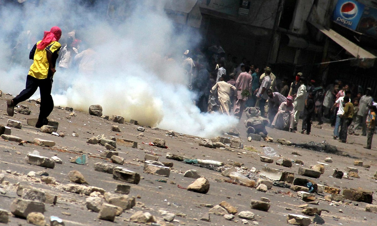 A riot in Lyari, Karachi, in September 2012 | Fahim Siddiquie, White Star