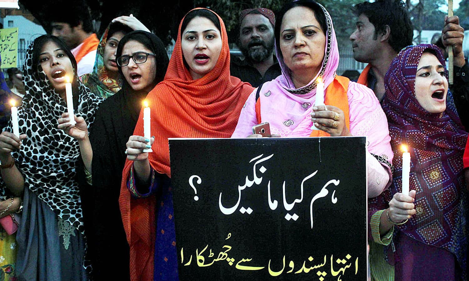 Members of Civil Society lit candles at Lahore's Faisal Chowk to pay tribute to the victims.— APP