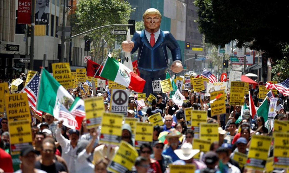 Demonstrators march with an inflatable effigy of Donald Trump during an immigrant rights rally in Los Angeles | earlier this year Reuters