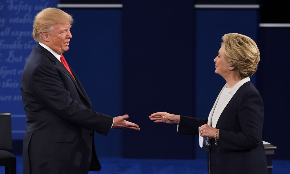 Donald Trump and Hillary Clinton shake hands after the second presidential debate in Missouri earlier this month | AFP