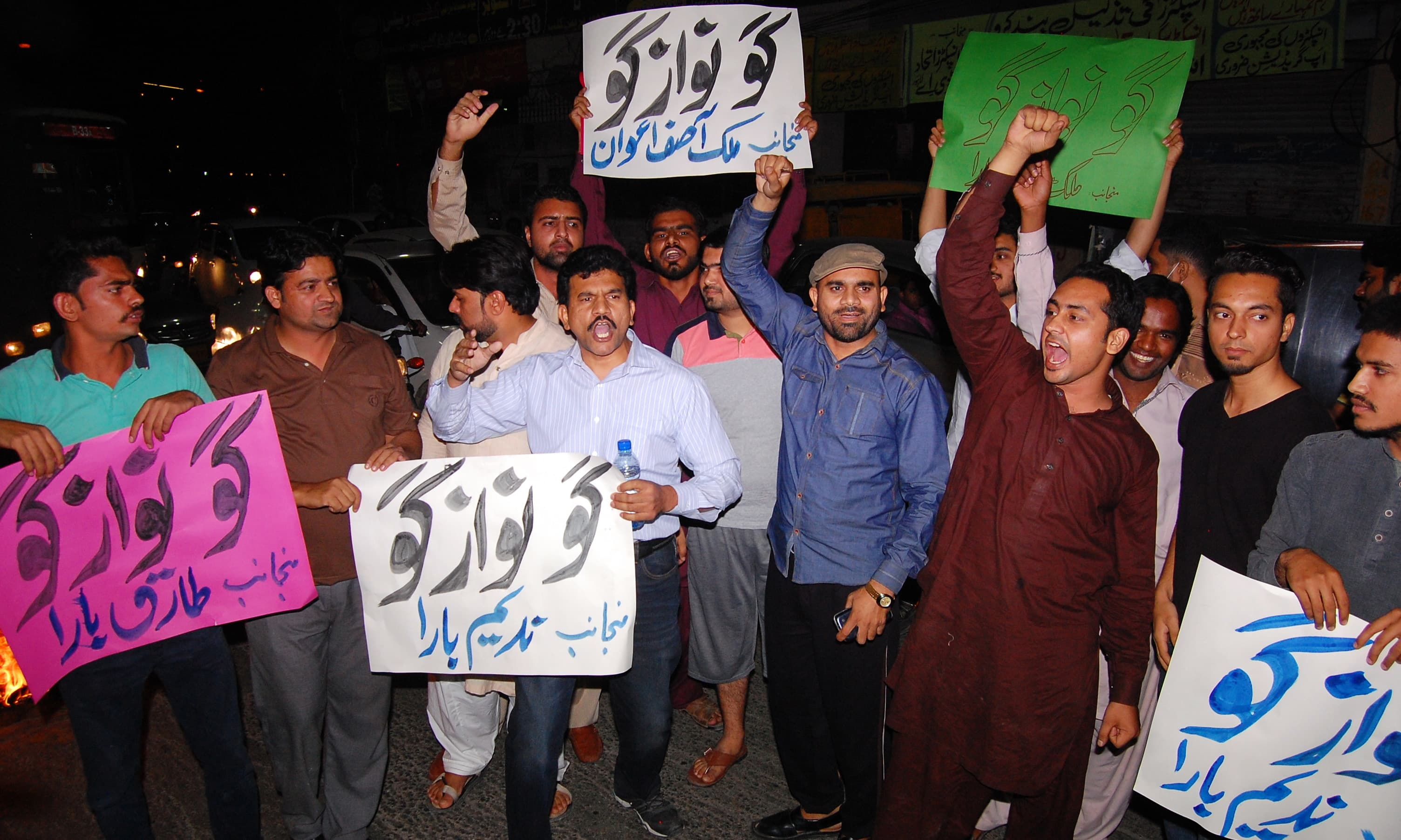 PTI supporters chant anti-govt slogans in Lahore. —AP