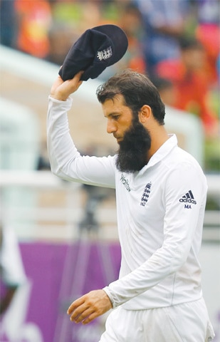 ENGLAND all-rounder Moeen Ali acknowledges the crowd as he leaves the ground, after taking five wickets, at the end of the Bangladesh innings.—AP