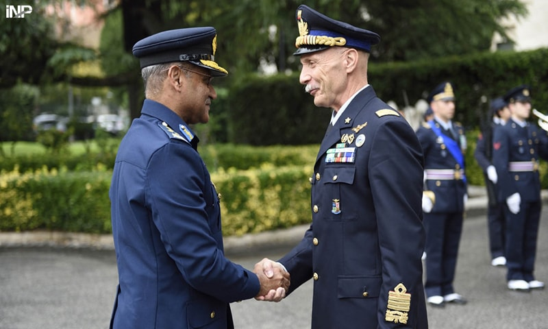 ROME: Air Chief Marshal Sohail Aman  is welcomed by his Italian counterpart Lt Gen Enzo Veccirelli during his visit tot the Italian Air Force headquarters on Friday.— INP
