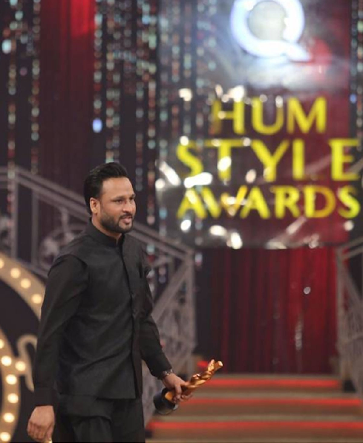 Shahbaz walking away with his award in hand. Photo: Instagram