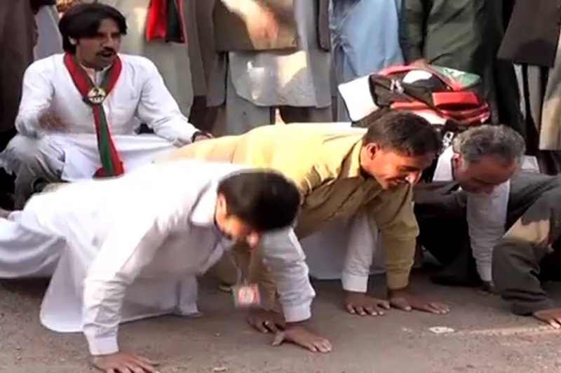 PTI supporters do push-ups in the morning near Bani Gala.