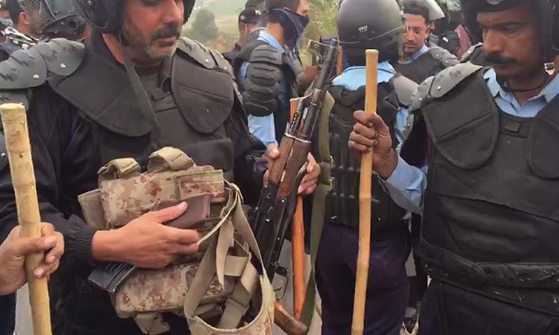 Police recover six Kalashnikov rifles from PTI leader Amin Gandapur's car. ─ DawnNews