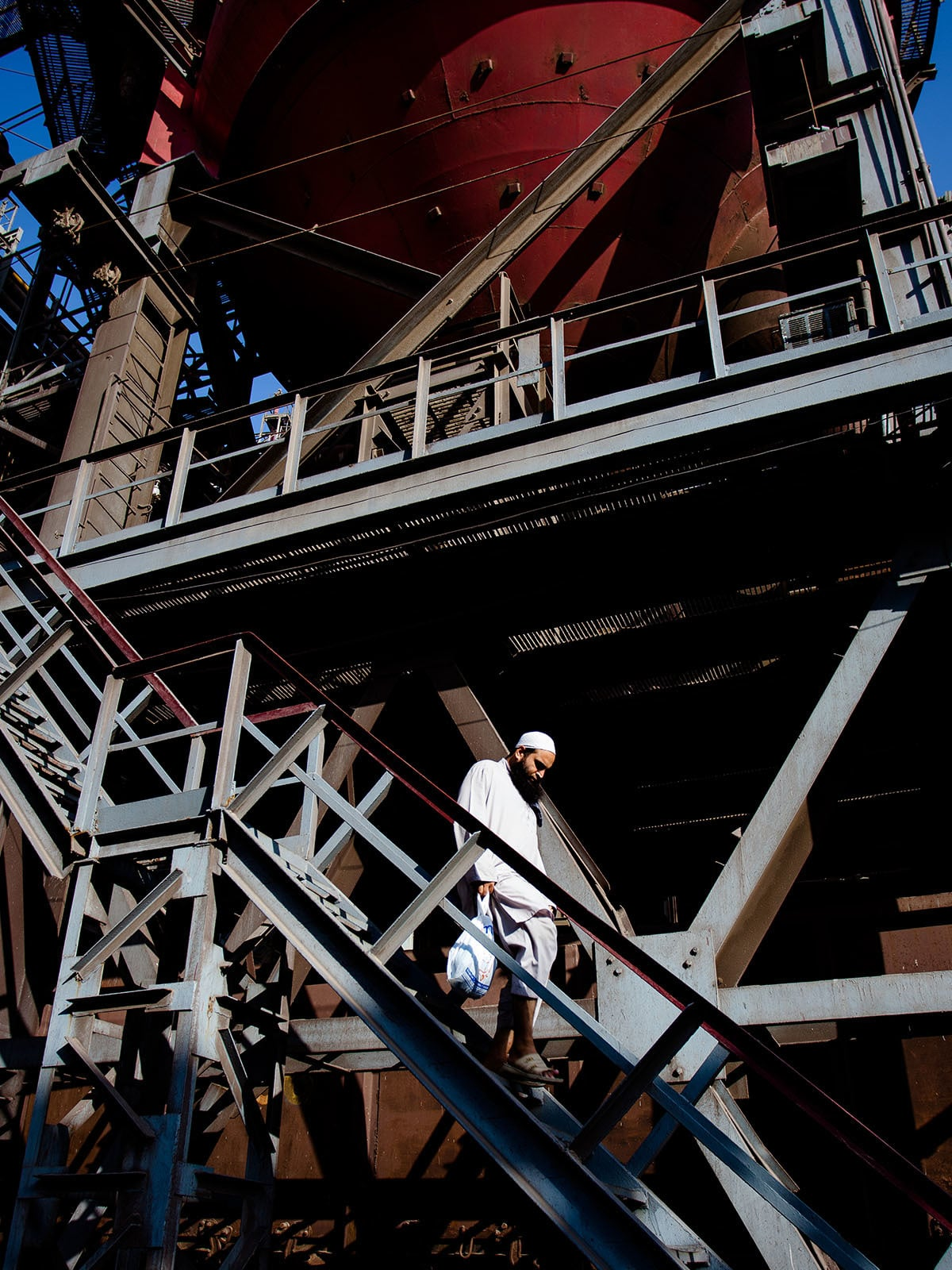 A man makes his way down from one of the blast furnaces at Pakistan Steel Mills
