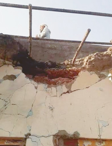 SIALKOT: A view of the roof of a village house along the Working Boundary which was damaged in Indian shelling on Sunday.—INP
