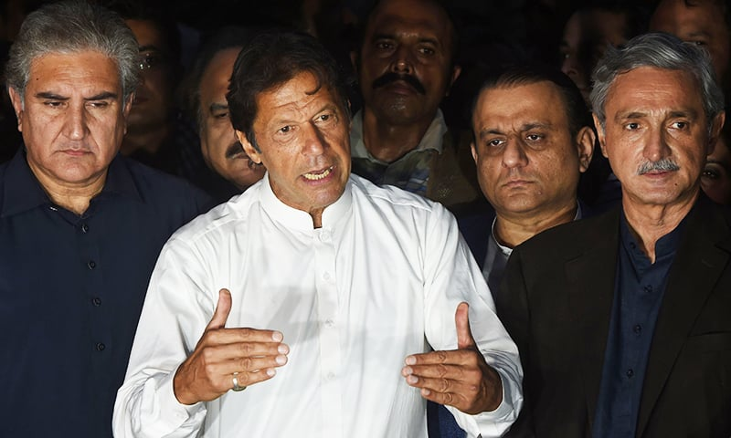 PTI chairman Imran Khan speaks during a press briefing outside his house in Islamabad on October 30.— AFP