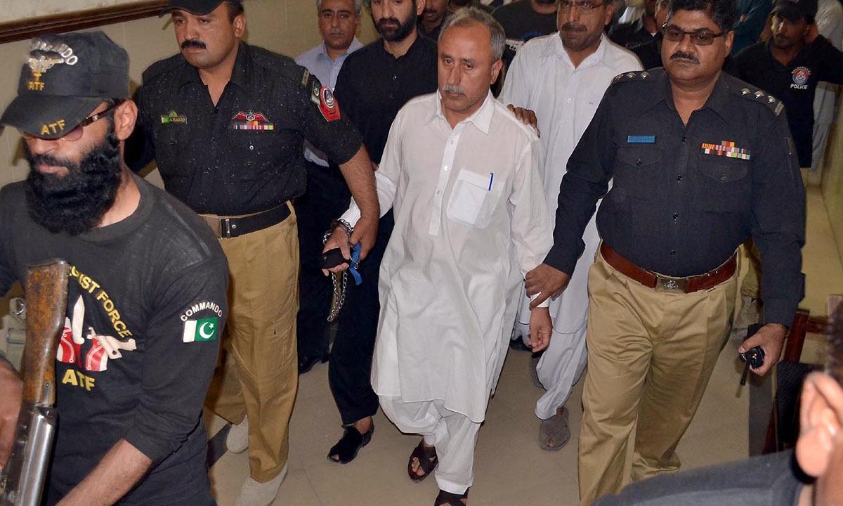 Police escort former Balochistan finance secretary Mushtaq Ahmed Raisani after a recent hearing in Accountability Court, Quetta   INP