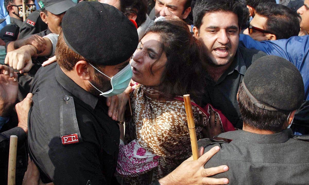 PTI Leader Andleeb Abbas is being rounded up before she was detained by police. —Online
