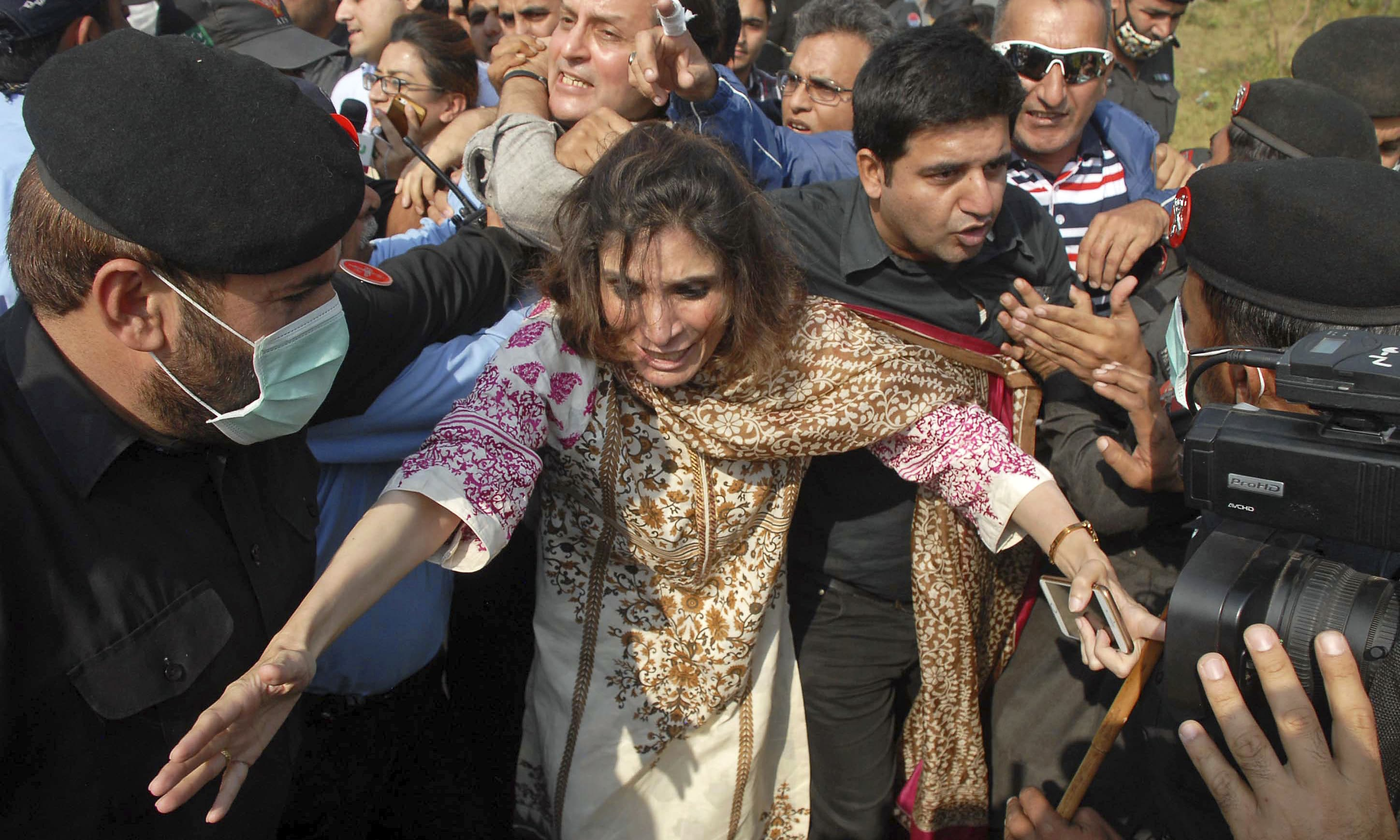 Security officials arrest supporters of opposition politician Imran Khan. —AP