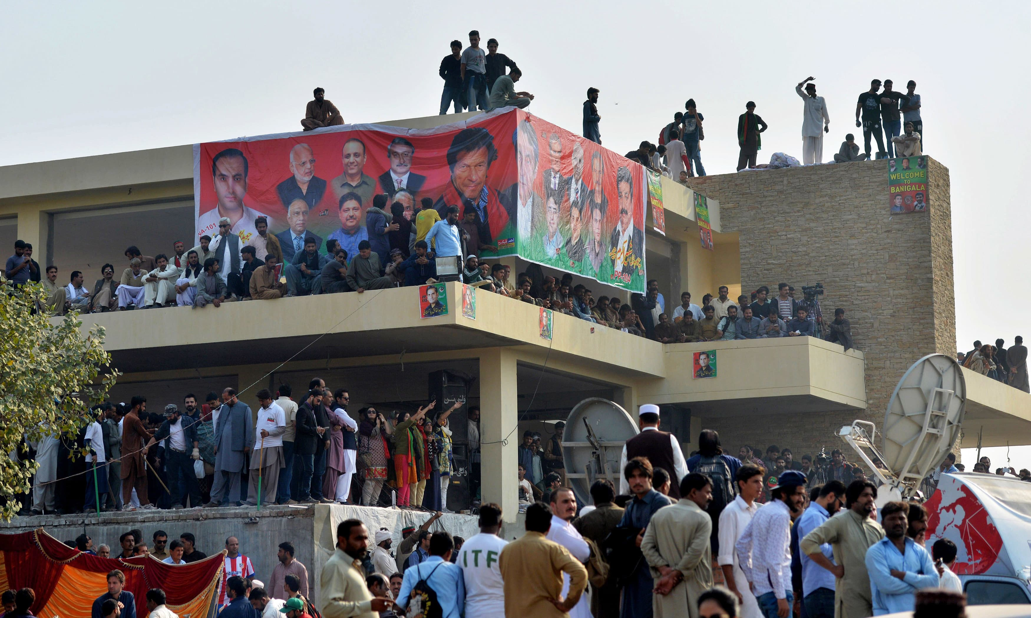 PTI activists gather to hear their leader. —AFP