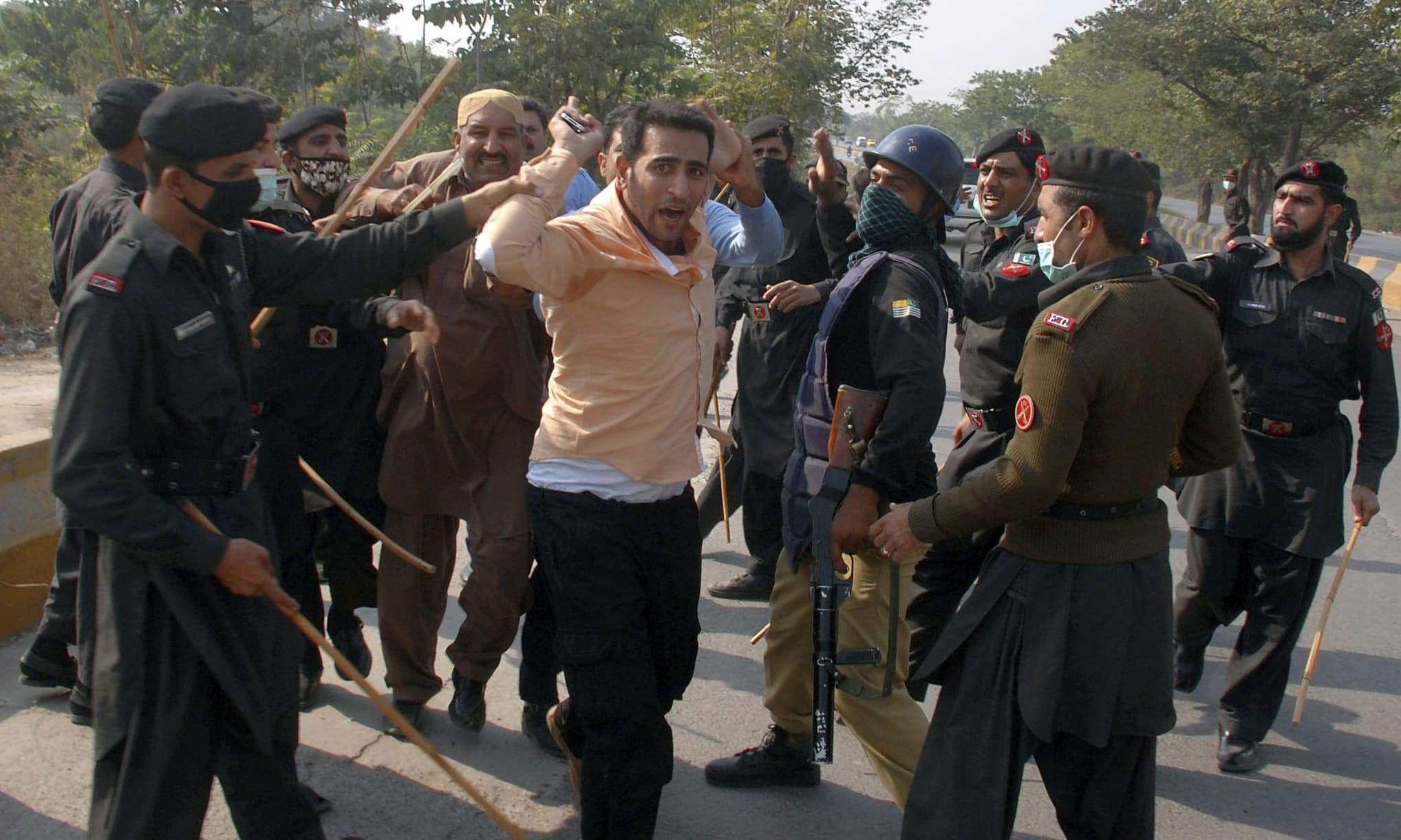 Security officials arrest PTI supporters in Islamabad. —AP