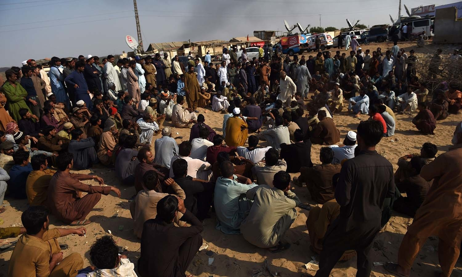Labourers gather following a gas cylinder explosion at the Gadani shipbreaking yard. ─AFP