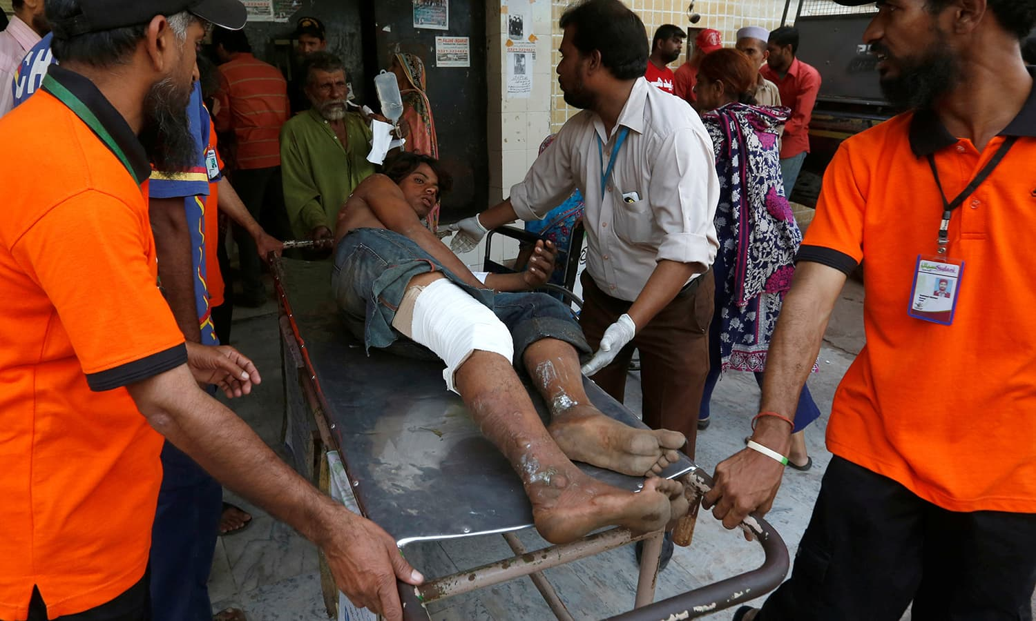 Rescue workers move a man who was injured after an explosion at the Gadani ship-breaking yard, at a hospital in Karachi. ─Reuters
