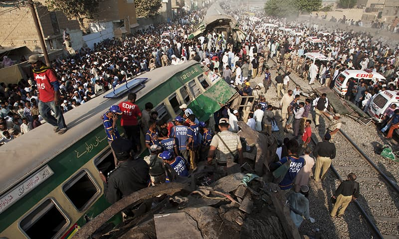 People look for victims in the wreckage of the trains in Karachi.— AP
