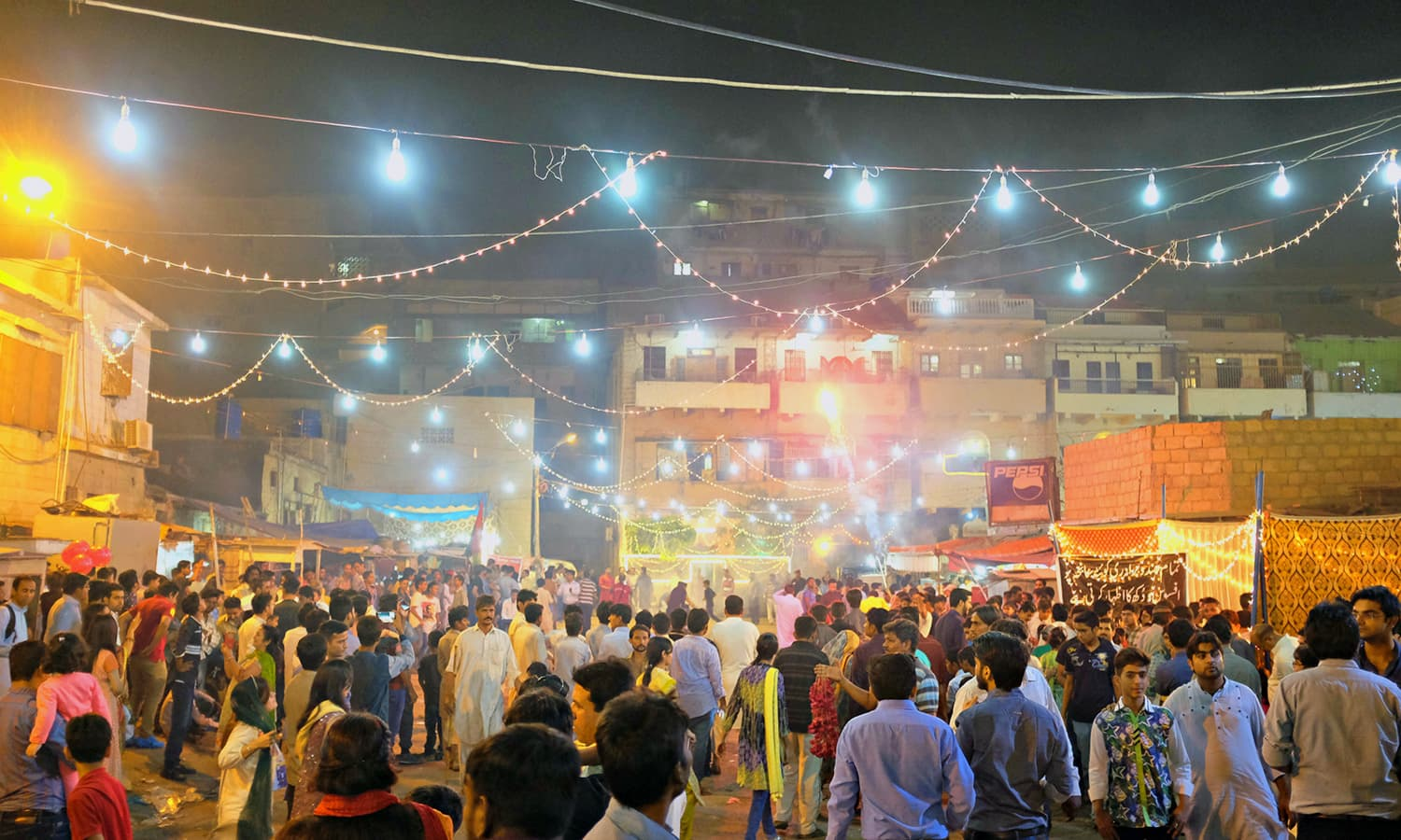 By the time we returned to the entrance, more people had joined the celebrations.