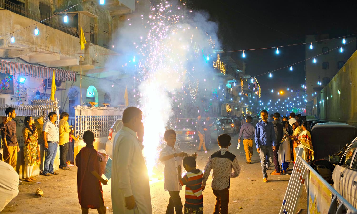 Firecrackers went off continuously as we briskly crossed the street.
